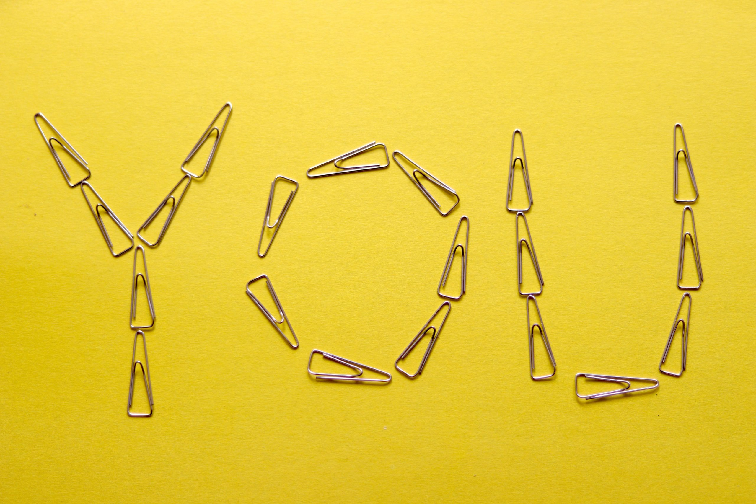 Paperclips spelling out the word YOU